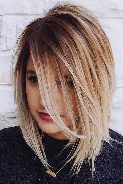 Corte largo en capas con cabello largo rubio